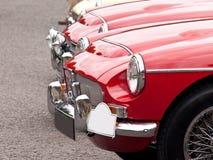 Las linternas de un coche de la vendimia en coche-muestran Foto de archivo
