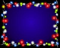 Las luces de la Navidad confinan el marco Imagen de archivo