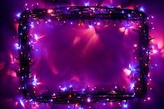 Las luces de la Navidad enmarcan el contexto Fotos de archivo libres de regalías