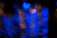 Las luces felices de la forma del corazón del amor del día de tarjetas del día de San Valentín diseñan en estilo del bokeh Fotografía de archivo libre de regalías
