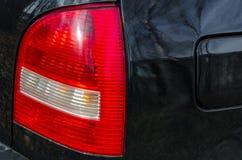 Las luces posteriores del coche fotos de archivo