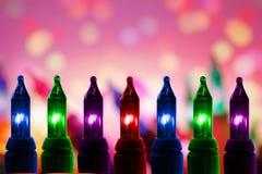 Las luces que destellaban coloridas en el De enfocaron el fondo del círculo con el espacio de la copia Foto de archivo libre de regalías