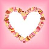 Las magdalenas, dulces, macarrones, pasteles vector el marco del corazón en fondo rosado Fotos de archivo