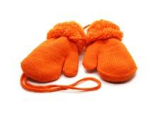 Las manoplas son calientes con la piel hecha del artículo de las lanas aislado en el fondo blanco foto de archivo