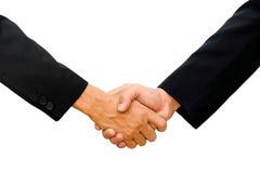Las manos de dos hombres de negocios están sacudiendo las manos Imagen de archivo libre de regalías