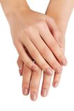 Las manos de la mujer con la manicura aislada Imágenes de archivo libres de regalías