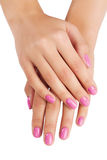 Las manos de la mujer con la manicura aislada Imagen de archivo