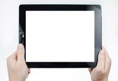 Las manos de la mujer que sostenían una tableta con blanco aislaron pedregal Foto de archivo
