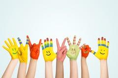 Las manos de los niños pintados Fotografía de archivo libre de regalías