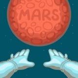 Las manos del astronauta estiradas al planeta rojo Marte Imágenes de archivo libres de regalías