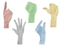 Las manos del gesto reciclaron el palillo del arte de papel Foto de archivo libre de regalías