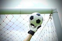 Las manos del portero del fútbol ahorran Imagen de archivo libre de regalías