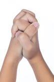 Las manos del ` s del niño doblaron juntas en rezo Imagen de archivo