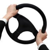 Las manos en un volante dan vuelta a la derecha Fotografía de archivo