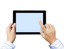 Las manos están señalando en la pantalla táctil, tablilla de tacto Imágenes de archivo libres de regalías