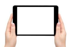 Las manos femeninas llevan a cabo el dispositivo móvil en un fondo blanco Imagenes de archivo