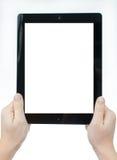 Las manos femeninas que sostienen una tableta tocan el artilugio del ordenador con el aislante Imágenes de archivo libres de regalías