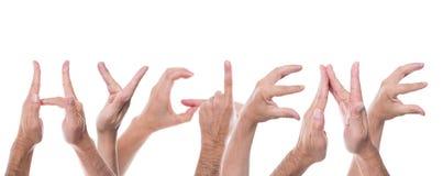 Las manos forman la higiene de la palabra foto de archivo libre de regalías