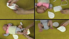 Las manos hacen la marca recién nacida de la palma de la huella del bebé Collage video metrajes