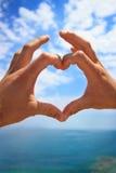 Las manos hacen la muestra del corazón Imagen de archivo libre de regalías