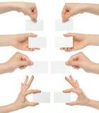 Collage de las tarjetas de visita del asimiento de las manos fotografía de archivo