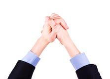 Manos masculinas puestas juntas en muestra del logro. Concepto del éxito. Imagen de archivo