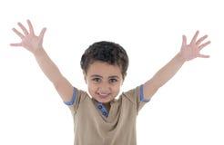 Las manos suben al muchacho feliz Imagen de archivo