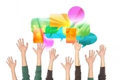 Las manos suben y una nube de medios sociales Foto de archivo libre de regalías