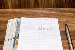 Las metas del Año Nuevo son resoluciones con el dólar Fotografía de archivo libre de regalías