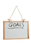 Las metas redactan en la tarjeta blanca Fotografía de archivo libre de regalías