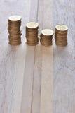 Las monedas apilan en fila Fotografía de archivo libre de regalías