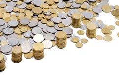 Las monedas dispersadas Foto de archivo libre de regalías