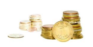 Las monedas empilan aislado Fotografía de archivo