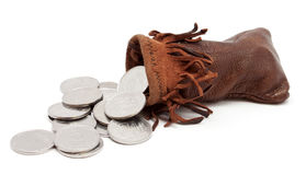 Las monedas que caen de la bolsa Fotografía de archivo libre de regalías
