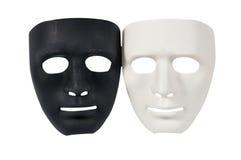 Las máscaras blancos y negros les gusta la conducta humana, concepto Fotografía de archivo