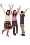 Las muchachas bastante felices aumentan sus manos Fotografía de archivo