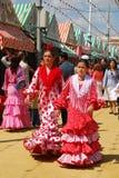 Las muchachas en flamenco se visten en la feria de Sevilla Fotografía de archivo libre de regalías