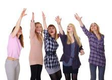 Las muchachas que se agrupan dan para arriba en blanco Imágenes de archivo libres de regalías