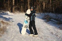 Las mujeres con un snowboard Imagenes de archivo