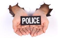 Las mujeres dan llevar a cabo policía firman fotografía de archivo