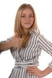 Las mujeres de negocios manosean con los dedos para arriba foto de archivo
