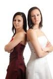 Las mujeres jovenes se visten detrás encendido detrás Fotografía de archivo libre de regalías