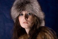 Las mujeres místicas hermosas en piel-casquillo Imagen de archivo libre de regalías