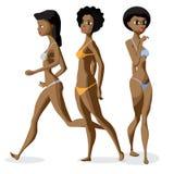 Las mujeres negras afro del sistema tres vestidas en traje de baño se están colocando Imagen de archivo