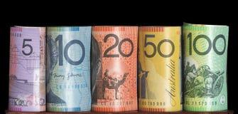 Las notas australianas rodaron el fondo negro Imagen de archivo libre de regalías
