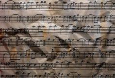 Las notas de la música texturizaron el fondo Fotos de archivo