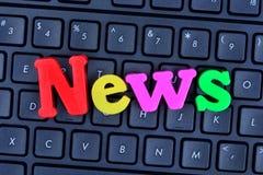 Las noticias de la palabra en el teclado de ordenador Foto de archivo libre de regalías