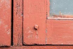 Las nueces empernan en la ventana de madera Fotos de archivo libres de regalías