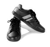 Nuevas zapatillas de deporte negras aisladas en el fondo blanco Fotos de archivo