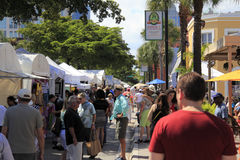Las Olas Art Fair Crowds. FORT LAUDERDALE, FLORIDA - MARCH 1, 2014: Crowds of people peruse and enjoy the large variety of art for sale at the weekend long Las royalty free stock photos